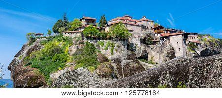 Panorama of Great Meteoro Monastery, Meteora rocks and tourists walking around