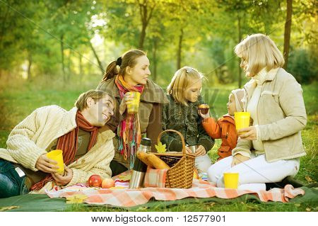 Happy Big Family in Autumn Park.Picnic.
