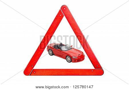 Red toy car cabriolet among warning triangle sign with red border on a light background