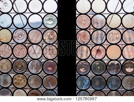 ancient castle window made of round shaped pieces glass