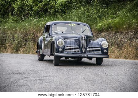 PESARO, ITALY - MAY 15: ALFA ROMEO 6C 2500 Freccia Oro 1948 on an old racing car in rally Mille Miglia 2015 the famous italian historical race (1927-1957) on May 2015
