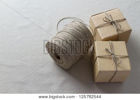 Cardboard boxes and a large spool of thread. Texture background