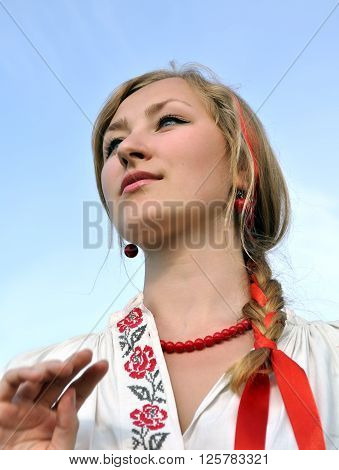 close-up portrait of young ukrainian woman in traditional clothes