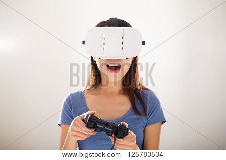 Woman play with joystiack and VR device
