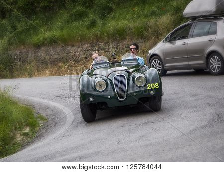 PESARO, ITALY - MAY 15: JAGUAR XK 120 OTS Sports 1950 on an old racing car in rally Mille Miglia 2015 the famous italian historical race (1927-1957) on May 15 2015