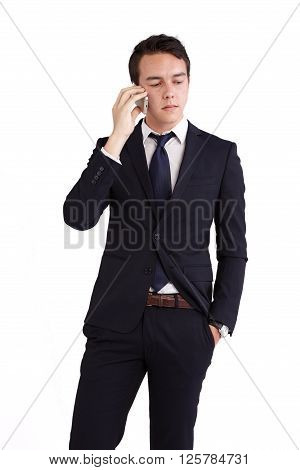 A young caucasian male businessman looking unhappy holding a mobile phone looking away from camera.
