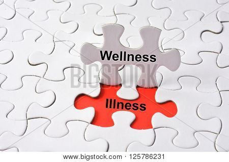 Wellness and Illness on red background concept on puzzle