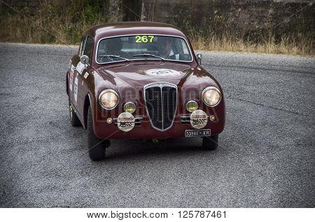 PESARO, ITALY - MAY 15: LANCIA Aurelia B20 GT 2500 berlinetta Pinin Farina 1953 on an old racing car in rally Mille Miglia 2015 the famous italian historical race (1927-1957) on May 2015
