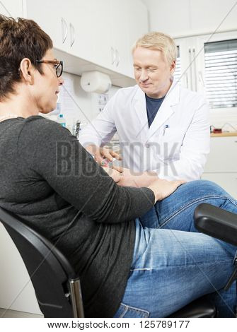 Doctor Collecting Patient's Blood For Test In Hospital