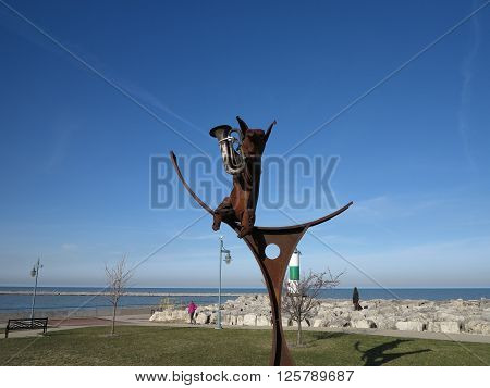 Iron artwork sculpture of musical pig playing horn in Kenosha, Wisconsin at Simmons Island