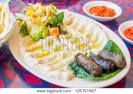 Plate of humus salad and sauces in a local arabic restaurant on Langkawi island Malaysia ** Note: Visible grain at 100%, best at smaller sizes