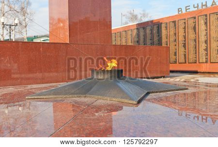 YUZHNO-SAKHALINSK RUSSIA - MARCH 17 2016: Eternal light of memorial (circa 1980) for soviet warriors died in Soviet-Japan war of 1945 in Yuzhno-Sakhalinsk Russia. Design of Alexander Turenkov