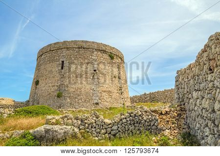 Torre den Penjat stone fort at Menorca, Spain.