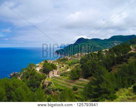 coastal landscape with terraced fields and the sea in banyalbufar majorca spain