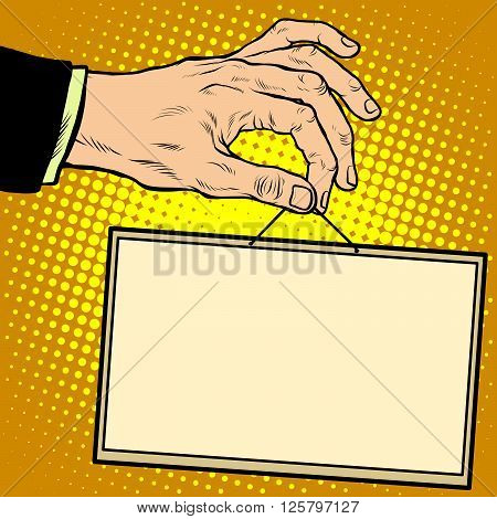 Hand holding a sign pop art retro style. Advertising signs. Vector business concept