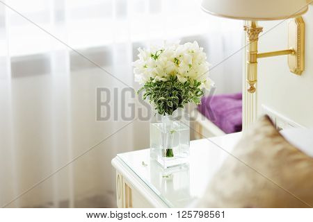 Wedding bouquet in vase. Bride's traditional symbolic accessory. Floral composition with white flowers.