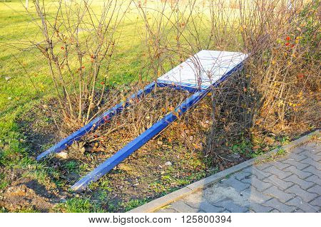 POZNAN POLAND - DECEMBER 06 2015: Information sign lying on the ground at a park