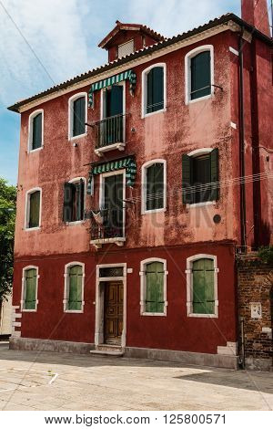 Ancient Red Facade In Murano Island Near Venice, Italy