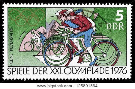 GERMAN DEMOCRATIC REPUBLIC- CIRCA 1976 : Cancelled postage stamp printed by German Democratic Republic, that shows cyclists.
