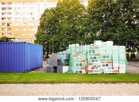 POZNAN POLAND - SEPTEMBER 23 2014: Stacks of isolation material by apartment blocks in the Piastowskie area