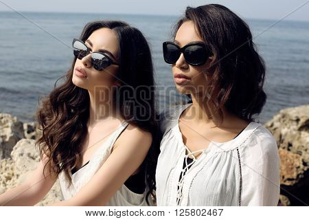 Beautiful Girls With Dark Hair Wears Casual Elegant Clothes And Sunglasses