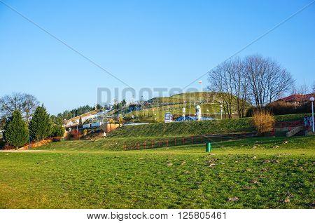 POZNAN POLAND - MARCH 27 2016: Green skill mountain with Polish flag on the Malta park
