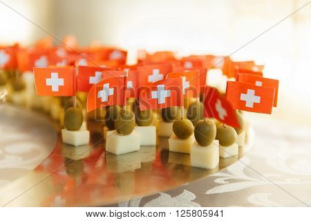 olives served with a small flag of Switzerland.