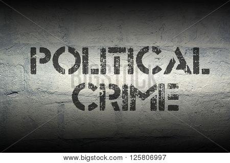 political crime stencil print on the grunge white brick wall