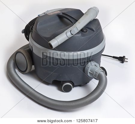 gray vacuum cleaner over isolated white background