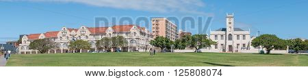 PORT ELIZABETH SOUTH AFRICA - FEBRUARY 27 2016: The historic King Edward Hotel built in 1903 and the historic Old Grey Institute built in 1858. The clock tower was added in 1875