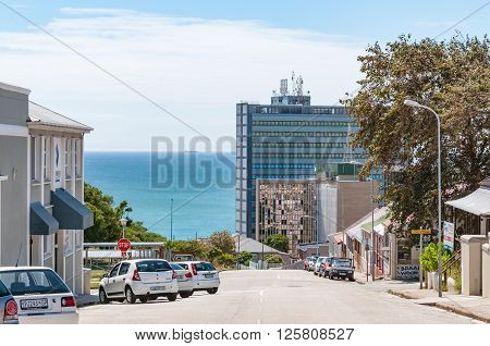 PORT ELIZABETH SOUTH AFRICA - FEBRUARY 27 2016: A street scene in Port Elizabeth with the Indian Ocean in the back