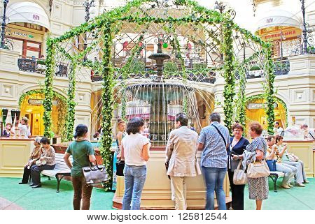MOSCOW, RUSSIA - JUNE 05, 2013: Fountain inside the GUM (main department store). GUM is located on the Red Square and is one of the oldest supermarkets in Moscow, Russia