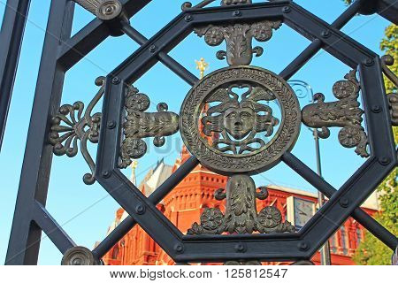 Wrought iron gate in the Alexander Garden near the Historic museum and Kremlin, Moscow, Russia