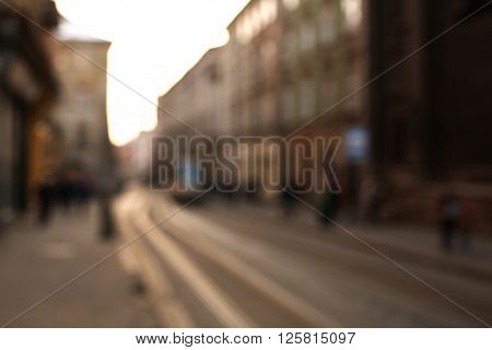 Blurred cityscape background the street of old town at sunset