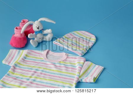 Baby Products on Blue Background with toy rabbit