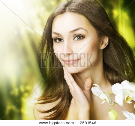 Spa Woman with long hair outdoor.Clear fresh skin