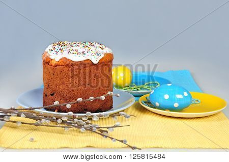 Table setting for Easter - Easter cakes and colored eggs. shallow depth of field