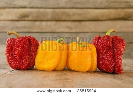 Wilted sweet peppers on a wooden table