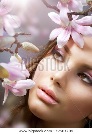 Beautiful Girl's face  with flowers