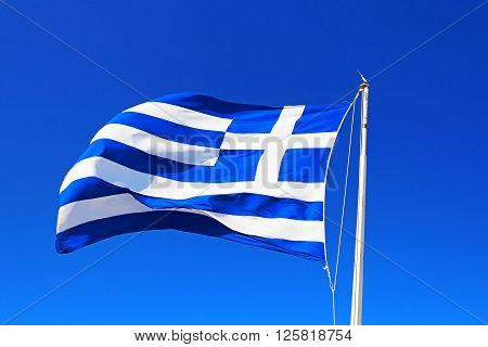 National flag of Greece over blue sky