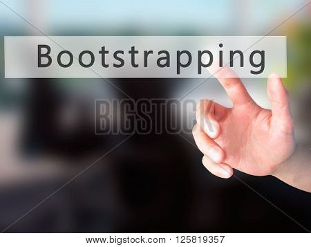 Bootstrapping - Hand Pressing A Button On Blurred Background Concept On Visual Screen.