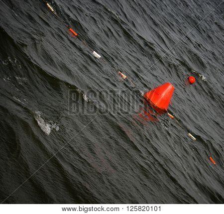 Floating red navigational buoy on lake in Ukraine