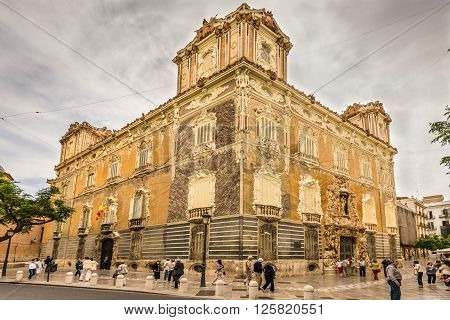 Valencia Spain - May 18 2014: Tourists around the building of the National Ceramics Museum Gonzalez Marti Valencia Spain (The historic Palace of Marques de Dos Aguas) in cloudy weather.