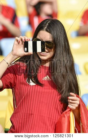RIO DE JANEIRO BRAZIL - June 18 2014: Twisters makes photo with mobile during the FIFA 2014 World Cup. Spain is facing Chile in the Group B at Maracana Stadium