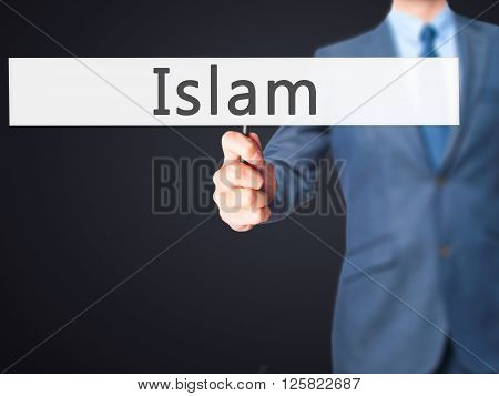Islam - Businessman Hand Holding Sign