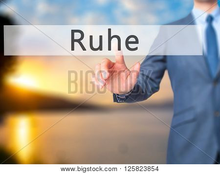 Ruhe (quiet In German) - Businessman Hand Pressing Button On Touch Screen Interface.