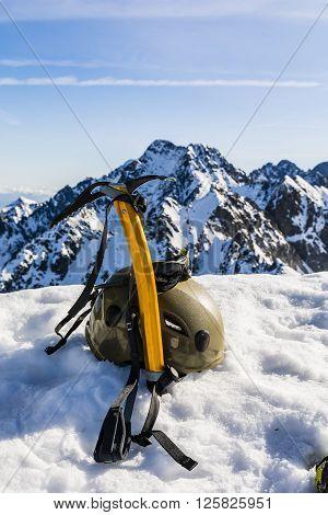 Ice Axe, Helmet And Glasses Glacier In The Mountains.