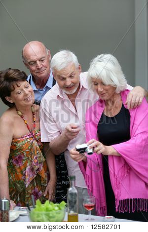 Senior group watching photos on a digital camera