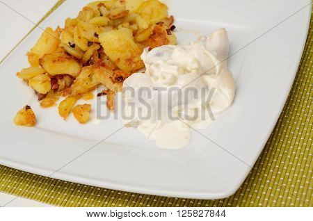 Herring in sour cream sauce with roasted potatoes