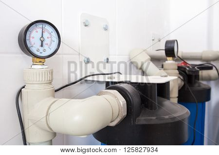 White thermometer in boiler room close up